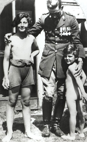 PK as youth with brother and father in uniform