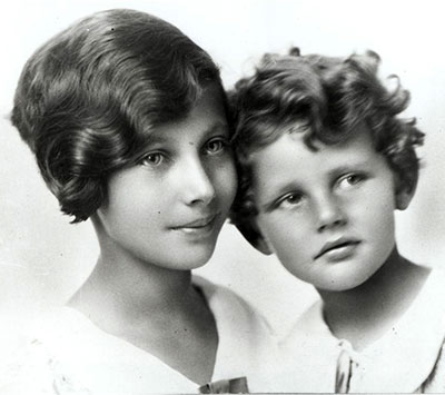 Portrait image of PK and Brother as children