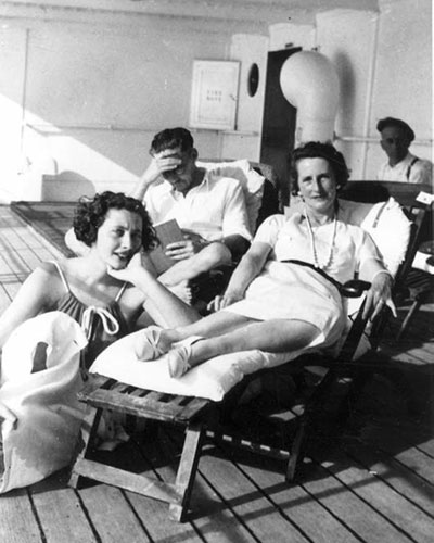 PK as young adult sitting with parents on ship deck